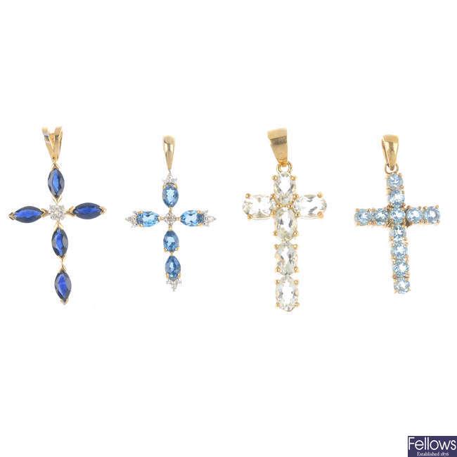 Four 9ct gold gem-set cross pendants.