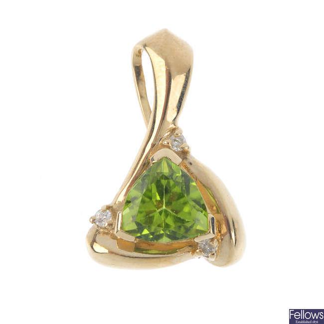 A 9ct gold peridot and diamond pendant.