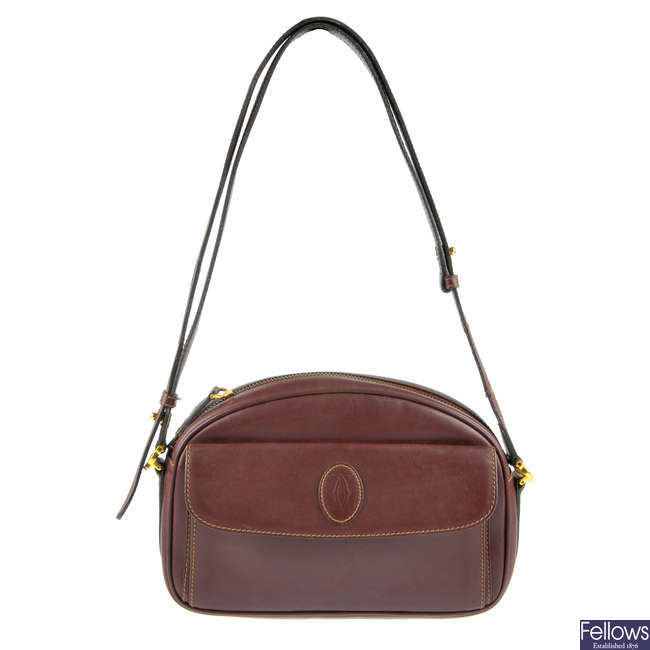 CARTIER - a Bordeaux crossbody handbag.