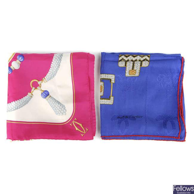 CARTIER - two Must De Cartier scarves.