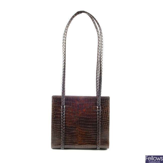 BALLY - a brown crocodile embossed handbag.