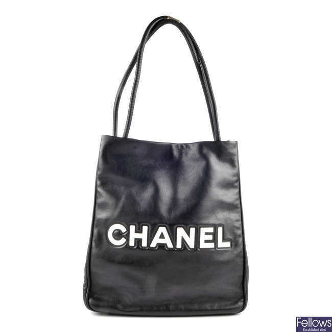 CHANEL - a black leather camellia tote.