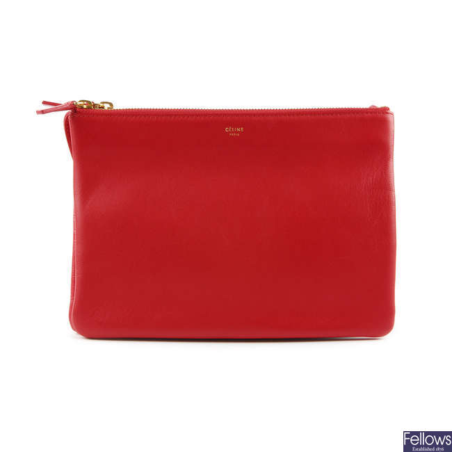 CELINE - a red leather Trio handbag.