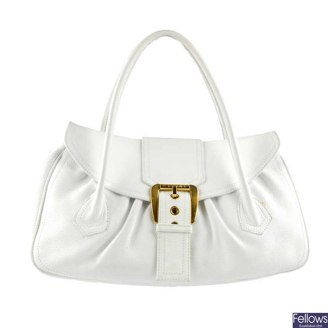 CELINE - a large white leather handbag.