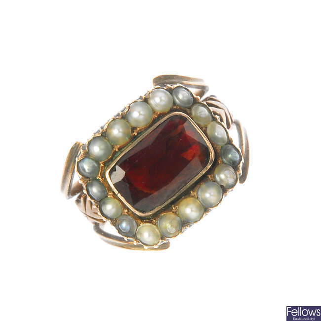 A late Georgian gold garnet and split pearl cluster ring, circa 1820.