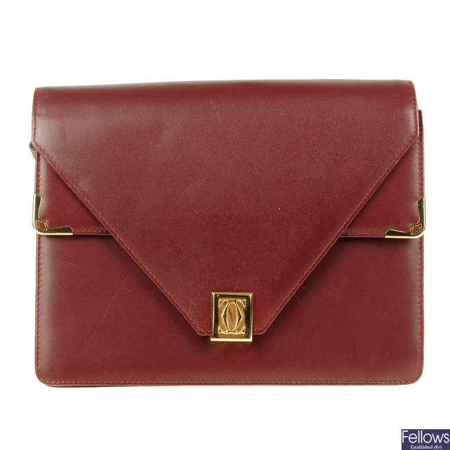CARTIER - a Bordeaux double flap handbag.