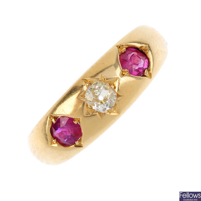 A late Victorian diamond and ruby three-stone band ring.