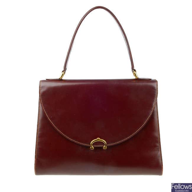 CARTIER - a Must Line Bordeaux leather handbag.