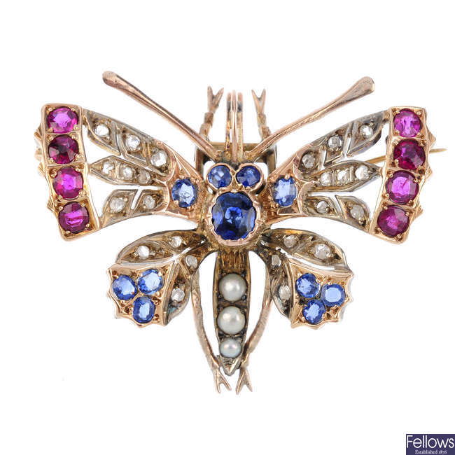A multi-gem insect brooch.