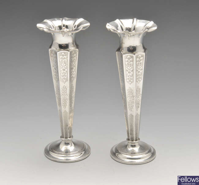 A pair of Edwardian silver bud vases.