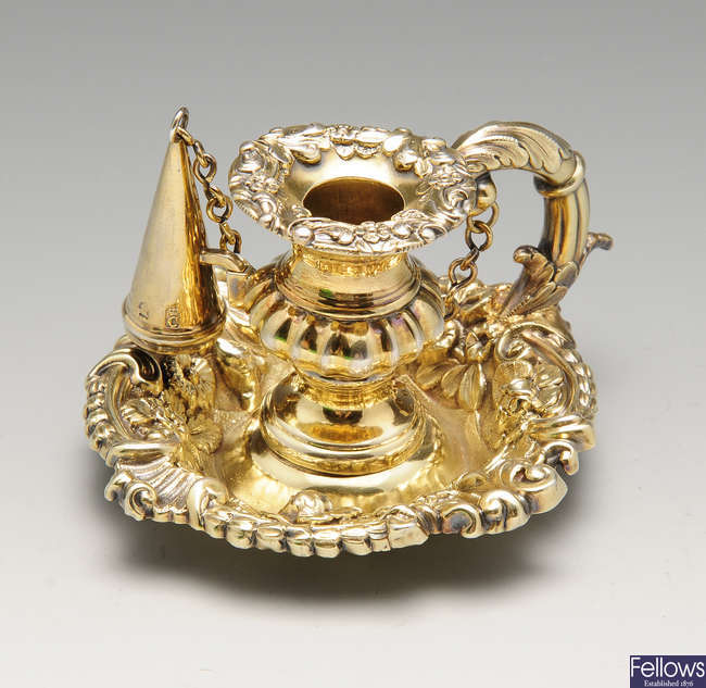 A silver-gilt chamberstick and snuffer.