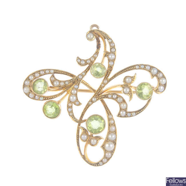 An early 20th century gold peridot and split pearl floral brooch.