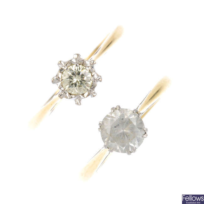 Two diamond and moissanite single-stone rings.