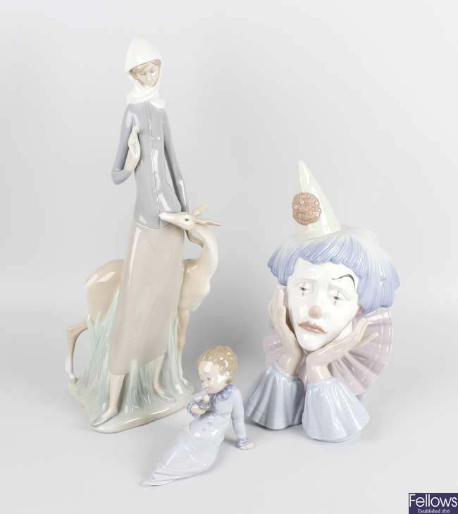 A group of four Lladro figurines.
