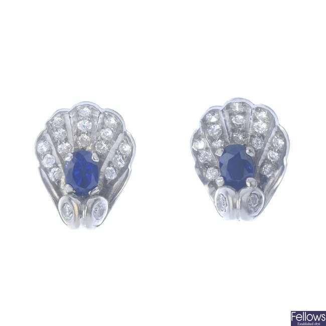 A pair of sapphire and diamond shell stud earrings.