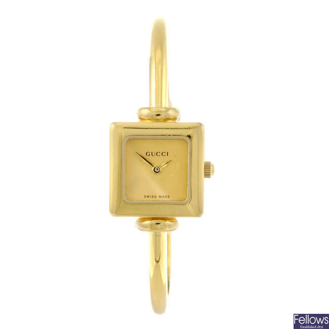GUCCI - a lady's gold plated 1900L bracelet watch with a gentleman's Raymond Weil wrist watch.