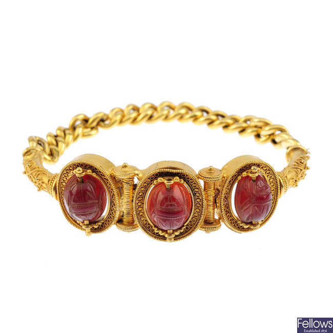 A mid Victorian gold hardstone Archeological and Egyptian revival bracelet, circa 1870.