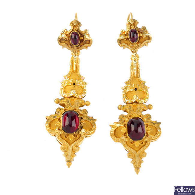A pair of mid Victorian gold garnet and serpent ear pendants.