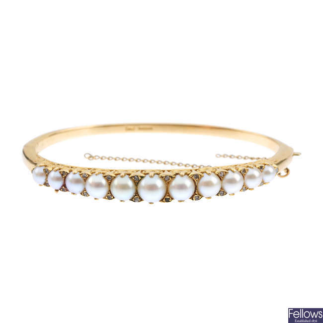 A 14ct gold cultured split pearl and diamond hinged bangle.
