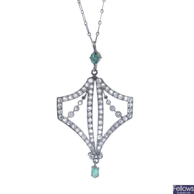A 1920s Art Deco platinum emerald and diamond pendant, with chain.