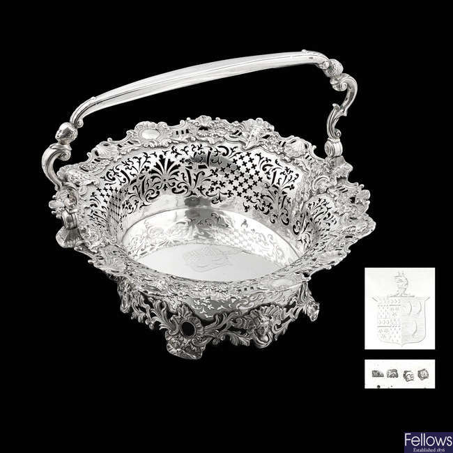 A George II silver swing-handled fruit basket by William Kidney.