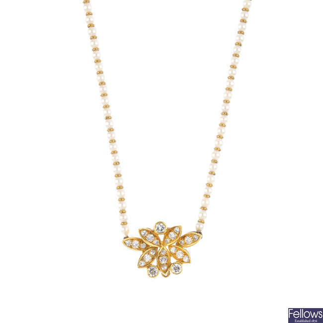 A seed pearl and diamond necklace.