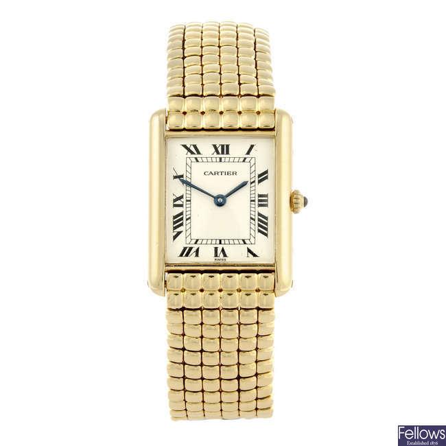 CARTIER - an 18ct yellow gold Tank bracelet watch.