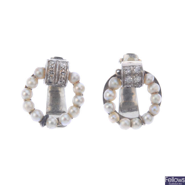 A pair of diamond and seed pearl clip earrings.