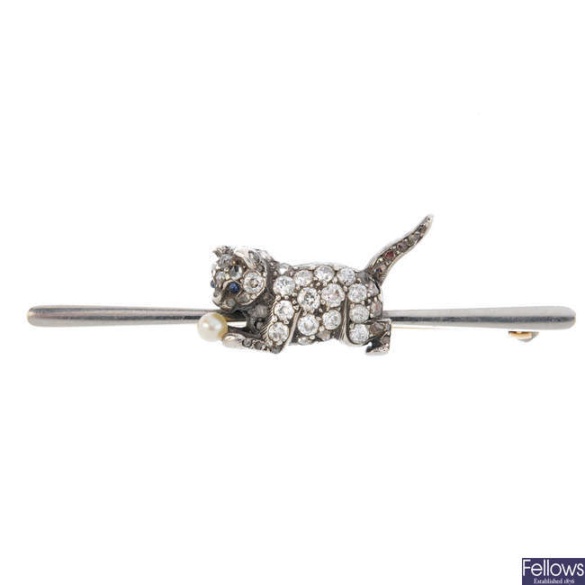 An early 20th century 15ct gold and silver diamond cat bar brooch.