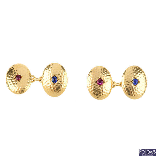 A pair of early 20th century 18ct gold ruby and sapphire cufflinks.