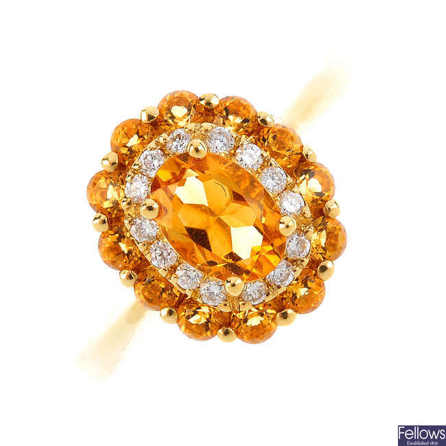 An 18ct gold citrine and diamond cluster ring.
