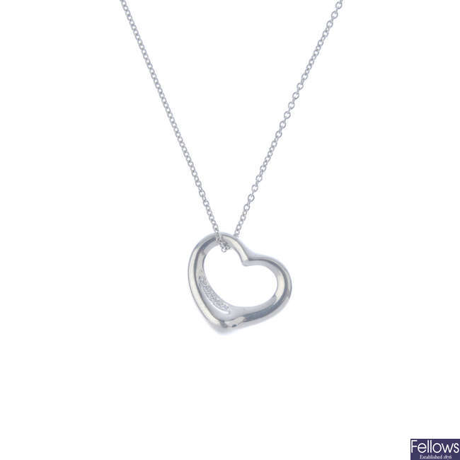 TIFFANY & CO. - a diamond 'Open Heart' pendant, with platinum chain.