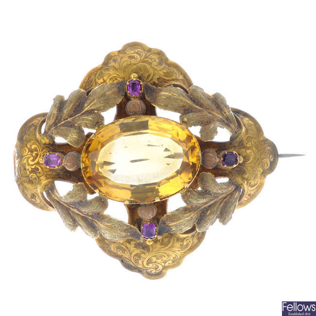 A mid Victorian gold, citrine and ruby brooch.
