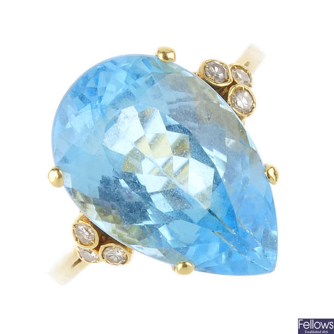 A topaz and diamond ring.