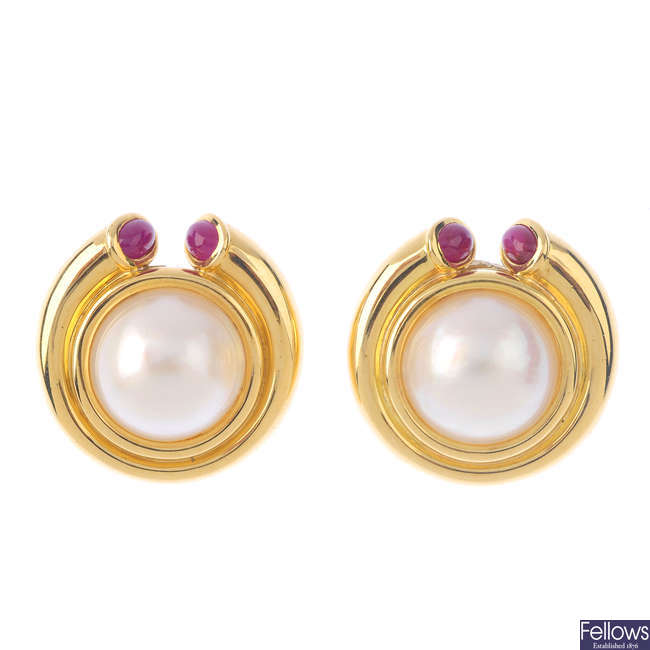 A pair of mabe pearl and ruby earrings.