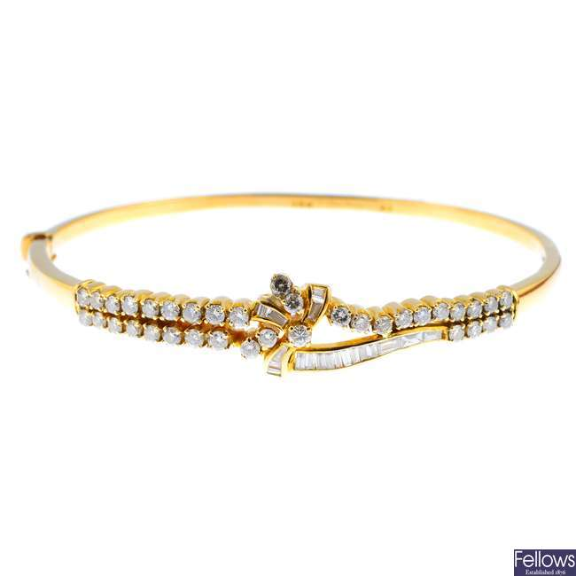 An 18ct gold diamond hinged bangle.