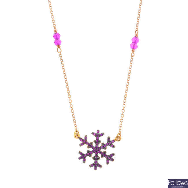 A synthetic ruby snowflake necklace.