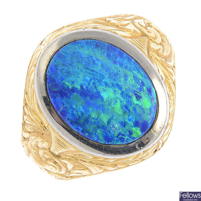 An opal triplet single-stone ring.