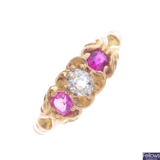 An 18ct gold synthetic ruby and diamond three-stone ring.