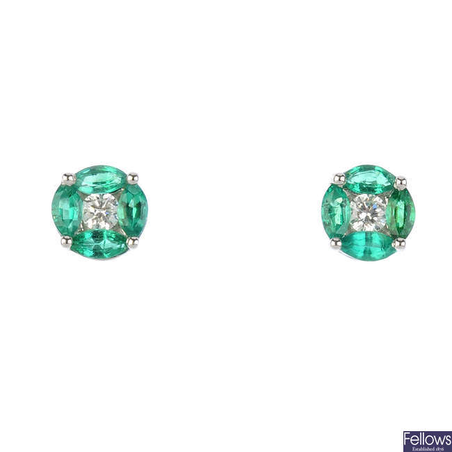 A pair of emerald and diamond cluster stud earrings.