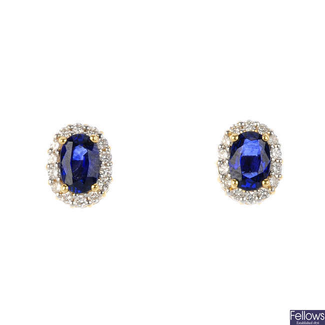 A pair of 18ct gold sapphire and diamond cluster stud earrings.