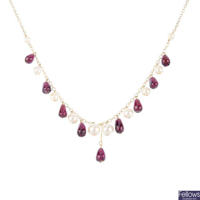 A selection of garnet jewellery.