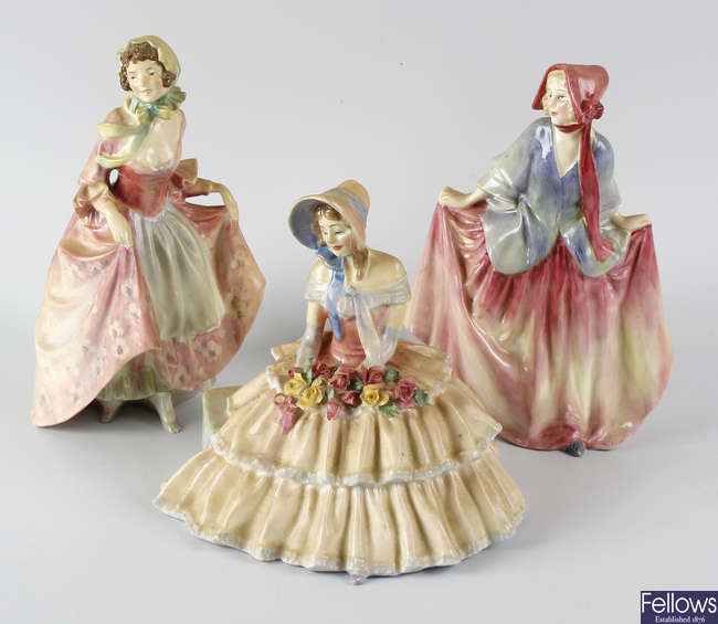 A group of six Royal Doulton figurines.
