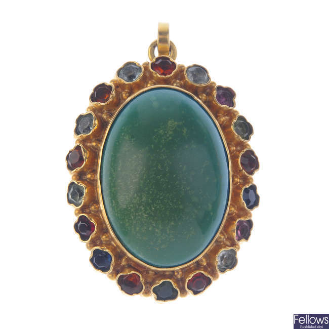 A turquoise and multi-gem pendant.