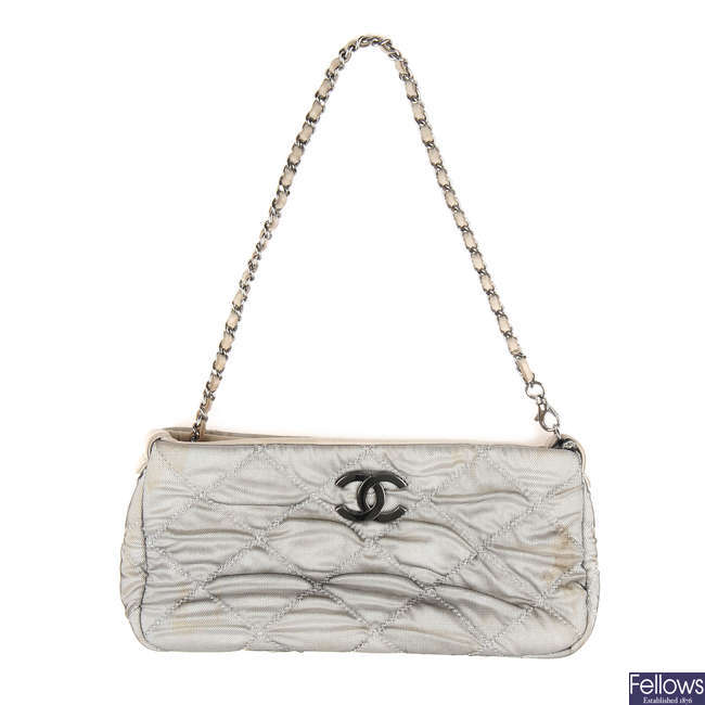 CHANEL - a grey quilted mesh evening bag.