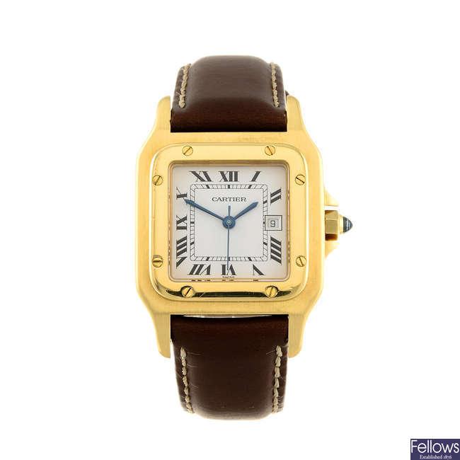 CARTIER - a yellow metal Santos wrist watch.