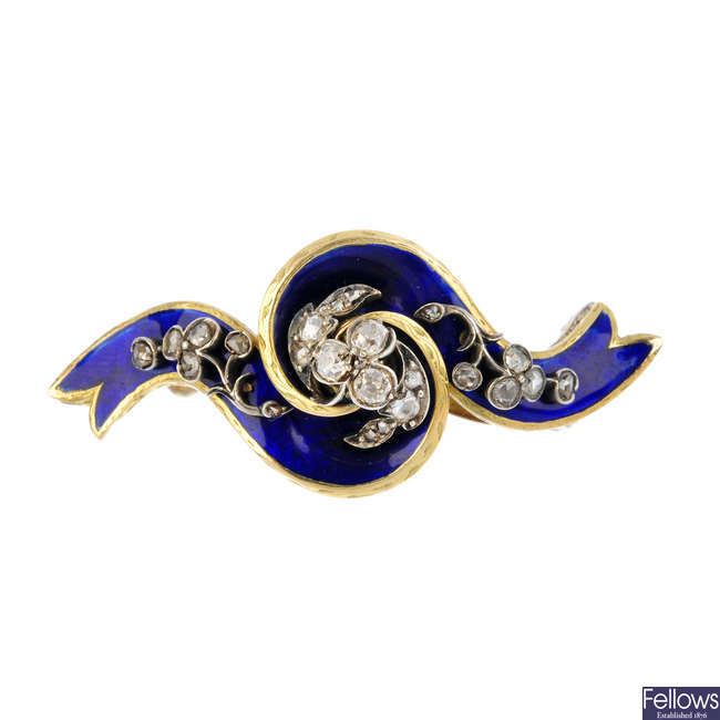 A late Victorian gold, diamond and enamel brooch.