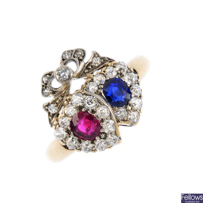 A late Victorian silver and gold, ruby, sapphire and diamond lover's hearts ring.