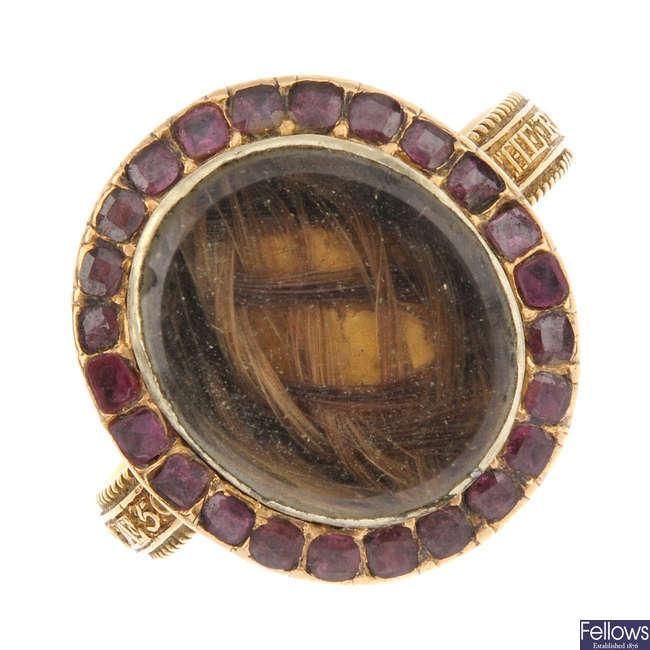 A George III garnet memorial ring.