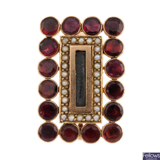 A mid Victorian gold garnet and split-pearl panel brooch.